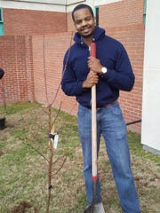 Daniel Farris, vice president of the Providence House board of directors,  recently helped his Rotary Club plant trees at Shriners Hospitals for Children in Shreveport.