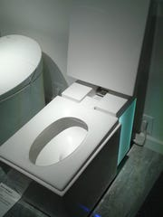 "The Numi is an ""intelligent"" toilet that plays music and has a square design and a heated seat."