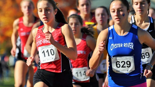Former Oyster River High School running star Maegan Doody, right, battles Coe-Brown's Liz Danis during a 2015 cross country race. Doody won three NHIAA Meet of Champions titles while at OR, and is currently looking forward to a fifth year at Georgetown University where her career has been marred by injuries.