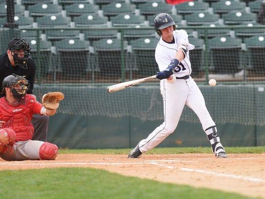 Augustana's Jordan Barth hits a home run during the