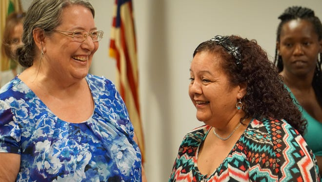 Lynn Ellyn (left) and incumbent Redford Township Treasurer Lily Cavanagh share a laugh during the recount canvassing Friday.