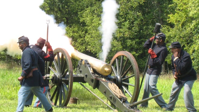"The cannon crew of the 12th United States Colored Heavy Artillery fired their Civil War cannon, ""Josephine"" at a Oldham County History Center event."