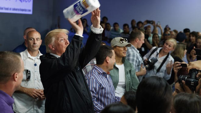 President Donald Trump tosses paper towels into a crowd in Guaynabo, Puerto Rico, on Oct. 3, 2017, during a visit after Hurricane Maria struck the island in September. ASSOCIATED PRESS ARCHIVE