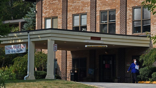 A person leaves Three Rivers Healthcare. The Connecticut Department of Public Health announced last week that Three Rivers Healthcare would be closing after several COVID-19 patient deaths and at least a number of other infections.