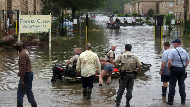Residents of Forest Creek Apartments who were forced to evacuate their residences due to flooding said Sunday that looters have broken into their apartments and stolen valuables, electronics and furniture.