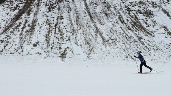 A woman cross-country skis in Kincaid Park in Anchorage,