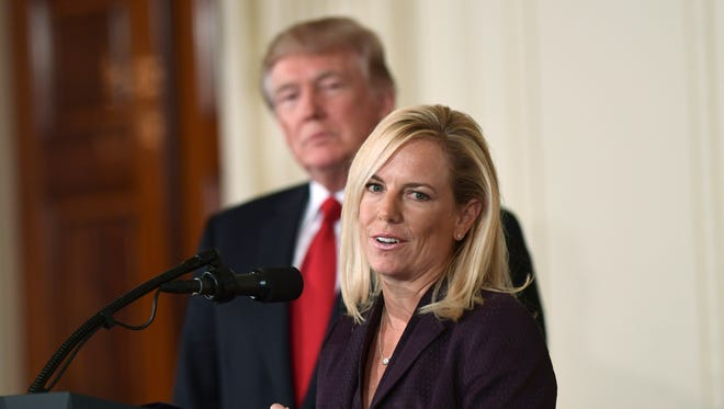 In this Oct. 12, 2017, file photo, President Donald Trump listens as Kirstjen Nielsen, a cybersecurity expert and deputy White House chief of staff, speaks in the East Room of the White House in Washington after Trump announced that she is his choice to be the next Homeland Security Secretary.
