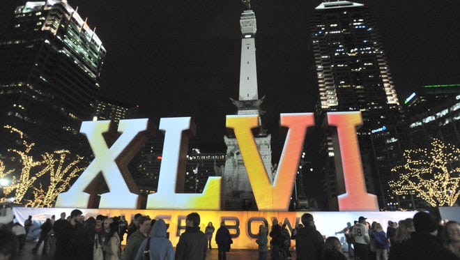 A huge crowd gathered on Monument Circle to watch the imagery and lights projected onto the Super Bowl XLVI Roman numerals in front of the Soldiers and Sailors Monument.