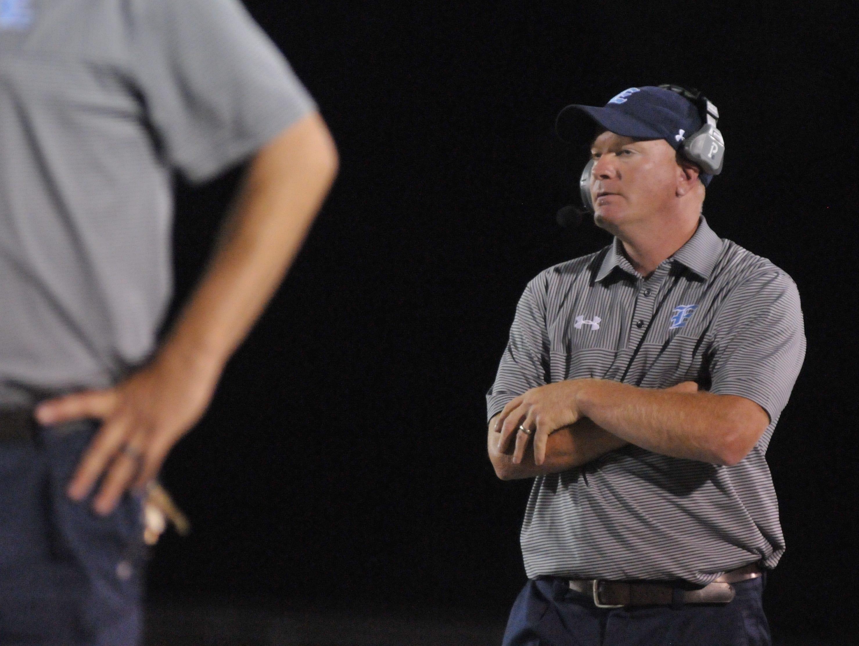 Enka football coach Jeff Frady.