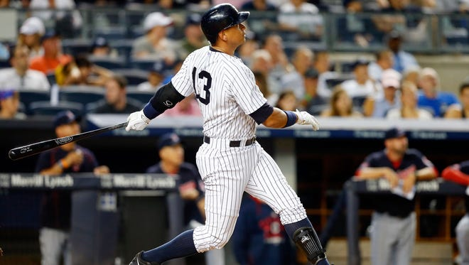 Alex Rodriguez follows through on his fourth-inning home run in a 3-2 loss to the Indians on Thursday.