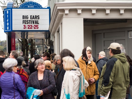 Festival goers wait in line to go into the Bijou Theatre