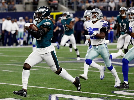 Philadelphia Eagles running back Jay Ajayi (36) leads Dallas Cowboys' Xavier Woods (25) and Byron Jones (31) on a long run as Ajayi carries the ball in the second half of an NFL football game, Sunday, Nov. 19, 2017, in Arlington, Texas. (AP Photo/Michael Ainsworth)
