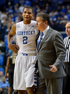 Kentucky Head Coach John Calipari shares a funny moment with Aaron Harrison during the second half at Rupp Arena in Lexington Tuesday Night. Kentucky won 65-57.