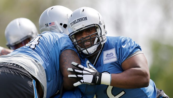 Detroit Lions guard Laken Tomlinson, right, runs a drill with Corey Robinson during an NFL football rookie minicamp in Allen Park on May 8, 2015,