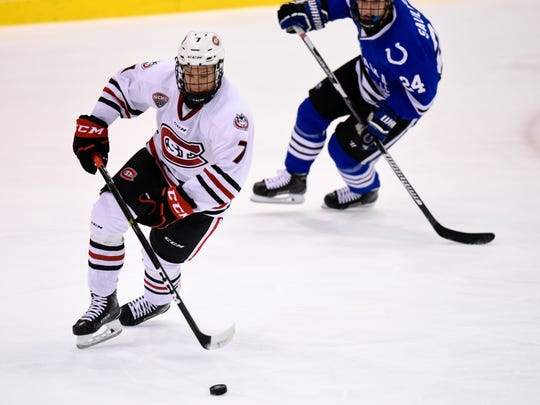 St. Cloud State's Niklas Nevalainen skates with the puck against University of Alabama-Huntsville's Brennan Saulnier during the first period of the Friday, Oct. 28, game at the Herb Brooks National Hockey Center in St. Cloud.