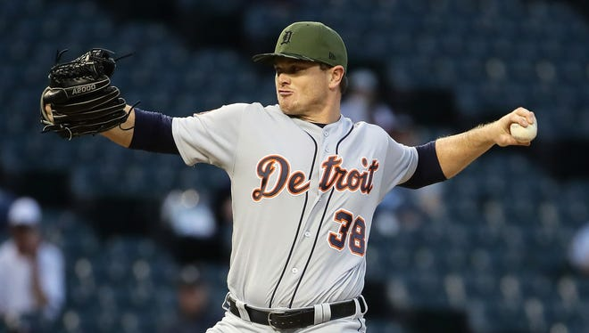 Justin Wilson pitches in the 9th inning of a Tigers 4-3 win over the White Sox.