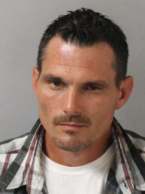 John Harris, 38, was found drunk with a loaded AR-15.