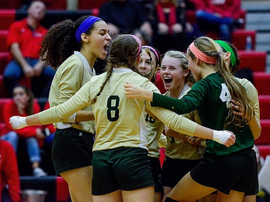 The York Catholic Fighting Irish girls' volleyball team celebrates after defeating Blue Ridge in a PIAA Class A first-round state volleyball match on Tuesday.