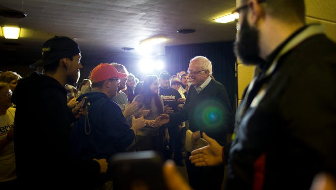 Democratic presidential candidate Sen. Bernie Sanders, I-Vt., shakes hands with supporters as he arrives at a campaign event, Saturday, Jan. 23, 2016, in Clinton, Iowa.