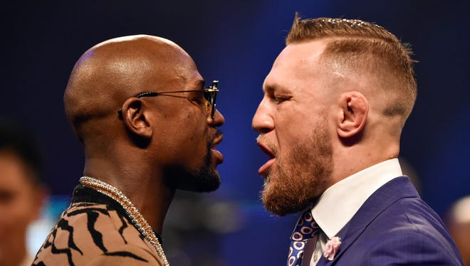 Conor McGregor and Floyd Mayweather face off during a world tour press conference to promote the upcoming Mayweather vs McGregor boxing fight at SSE Arena.