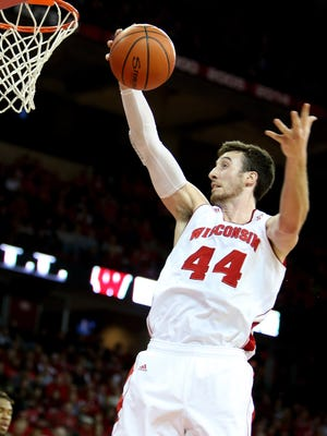 Frank Kaminsky attempts a basket at the Kohl Center.