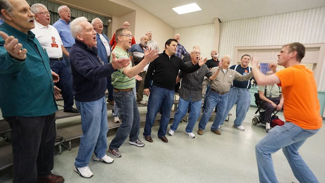 Trevor Garrabrant leads the Fun Center Chordsmen's rehearsal at the First Congregational Church on Monday.