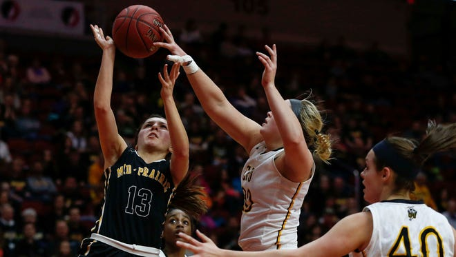 Center Point-Urbana sophomore Sydney Boevers, right, blocks a shot attempt by Mid-Prairie senior Alex Rath during the Iowa high school girls state basketball tournament on Tuesday, March 1, 2016, at Wells Fargo Arena in Des Moines.