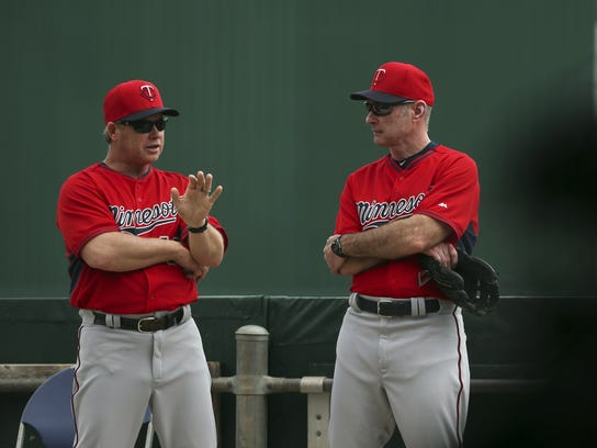 Minnesota Twins bench coach Joe Vavra, left, and manager Paul Molitor talk while while watching pitchers and catchers throwing in the bullpen during a spring training workout Monday Feb. 23, 2015 in Fort Myers, Fla. (AP Photo/Star Tribune, Jeff Wheeler) ST. PAUL PIONEER PRESS OUT. MINNEAPOLIS AREA TV OUT MAGS OUT