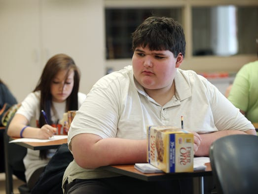 Franklin High School freshman Eric Ekis started high school weighing around 500 pounds. Thanks to the help of teachers Don Wettrick and Lesleigh Groce, he has started to exercise more and to improve his eating habits. Here Ekis and others learn how to read the nutrition labels on packaged food.