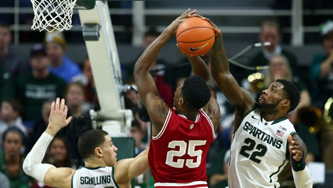 Hoosiers forward Emmitt Holt (25) has shot blocked by Michigan State Spartans guard/forward Branden Dawson (22) during the 2nd half  a game at Jack Breslin Student Events Center.