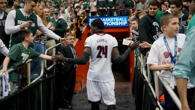 U of L's Montrezl Harrell is congratulated by Michigan State fans as he leaves the court after the game.  March 27, 2015.