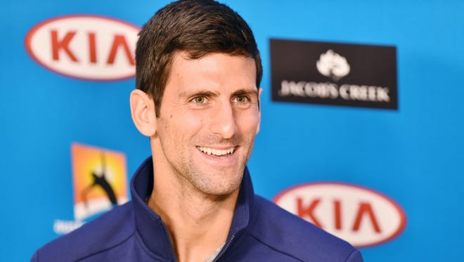 Novak Djokovic of Serbia reacts during a press conference ahead of the Australian Open tennis tournament at Melbourne Park, in Melbourne, Australia.
