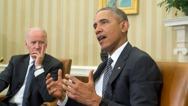 President Obama delivers remarks beside Vice President Biden after receiving a briefing on the response to the Zika virus in the Oval Office Friday.