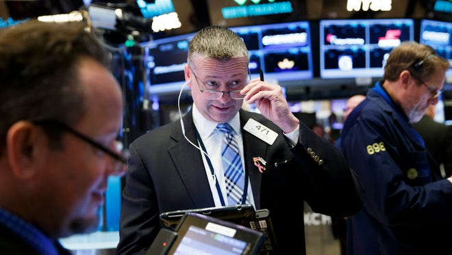 Traders react on the floor of the New York Stock Exchange.