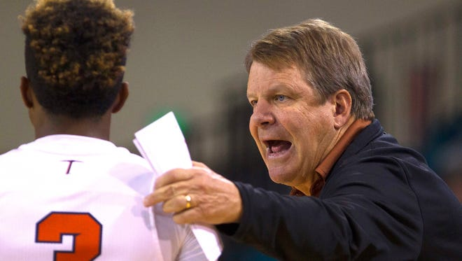 UTEP coach Tim Floyd talks with guard Evan Gilyard during the first half of their game against South Carolina at The HTC Center in Conway, S.C.