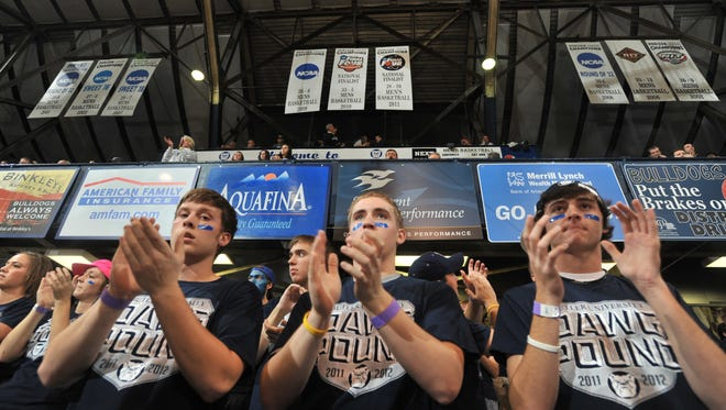 Fans applaud after the Final Four Banner earned by the Butler Bulldogs for their appearance in the 2011 NCAA Finals was raised before the start of the game between the Butler Bulldogs and the Chattanooga Mocs at Hinkle Fieldhouse at Butler University in Indianapolis, Nov. 15, 2011.