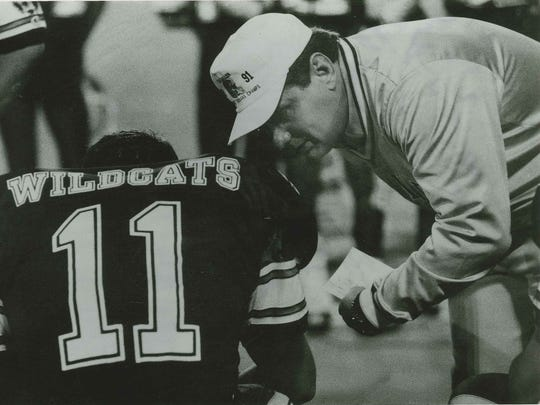 Calallen coach Phil Danaher talks to son Cody. Cody played quarterback for the Wildcats.