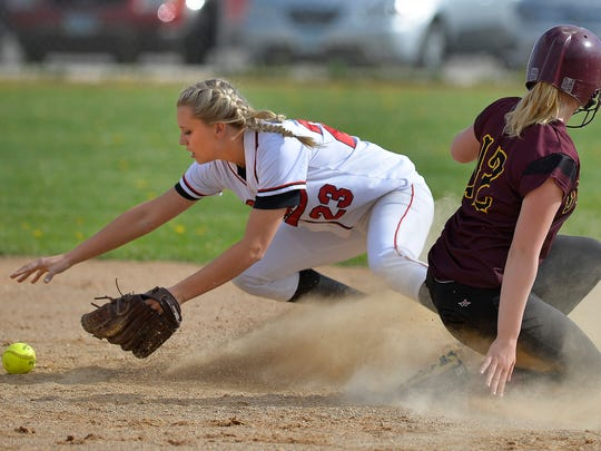Rocori High School second baseman Chelsea Schroeder (23) tries to get a handle on the ball as Fergus Falls' Chandler Frigaard (12) slides in safely in the sixth inning of their first game of a double header Tuesday, May 17, at Rocori. Rocori went on to win the first game 6-1.