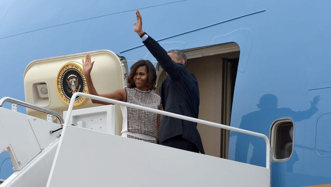 President Obama and first lady Michelle Obama board Air Force One at Andrews Air Force Base in Maryland on May 14, 2014.