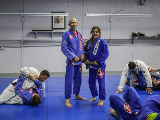 Professor Jacob Benitez and his wife, Program Director Angela Benitez, pose for a photo during practice at Gracie Barra Las Cruces Brazilian Jiu-Jitsu and Self-Defense.