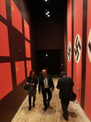 Visitors walk  in the Museum of the Second World War,
