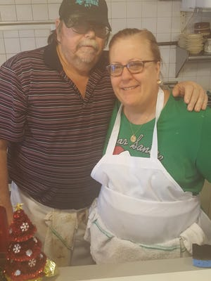 Jim and Brenda Roth, owners of Dave's Diner, love to play Santa's helpers.
