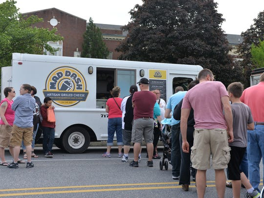 Line for the Mad Dash Food Truck at the Palmyra Truck Trek held on West Cherry Street at Palmyra on Saturday, May 14, 2016.
