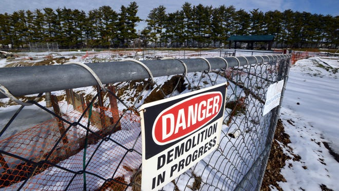 Ice fills part of a large fenced-off pit Thursday, Jan. 14, 2016, at Glassco Park in Lancaster. The pit is where a pump station is supposed to go as part of a project that has closed parts of the westside park since the fall of 2014. Work is at a standstill until a new contractor can begin work on the project.