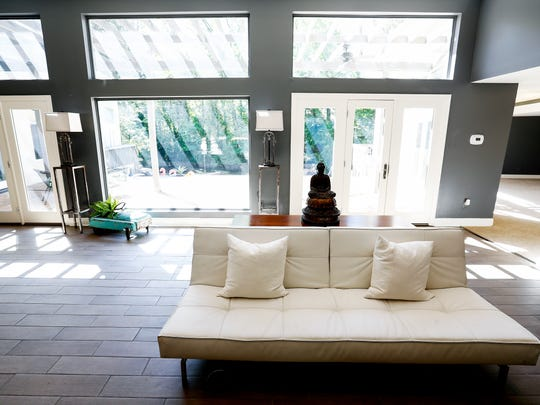 Large window offer natural light throughout the four bedroom, four full bath home at 6003 Manor Cove that is listed at $550,000