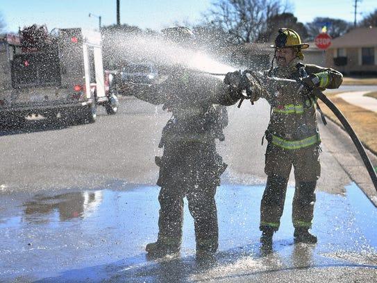 Wichita Falls firefighter Dakota Schweiger gets washed