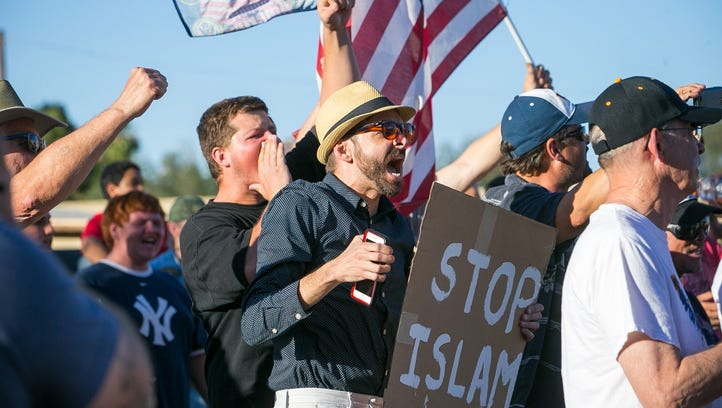 Anti-Islam protesters gather outside a mosque May 29,