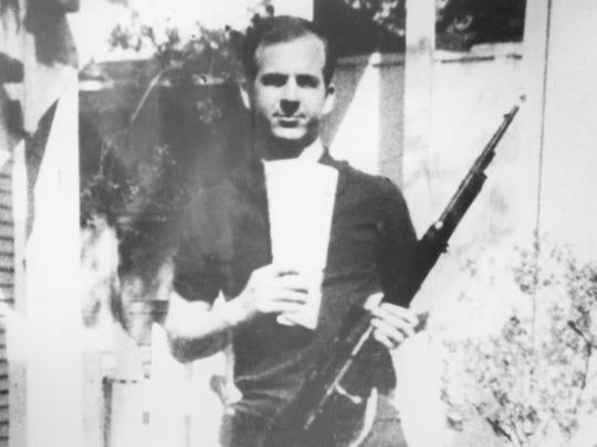 Lee Harvey Oswald, holding a surplus Italian rifle