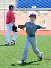 Joshua Brooks, 10, of Roswell throws the ball back to the infield during outfield drills Monday at Bob Forrest Youth Sports Complex.