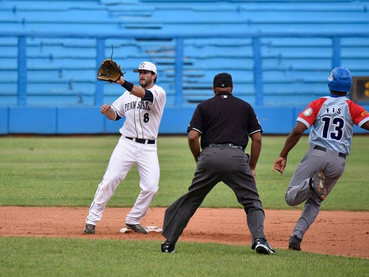 Penn State's Christian Helsel (8) catches a throw at second base before tagging out Ciego De Avila base runner Yoelvis Fis (13) at Latin American Stadium in Havana, Cuba on Wednesday.